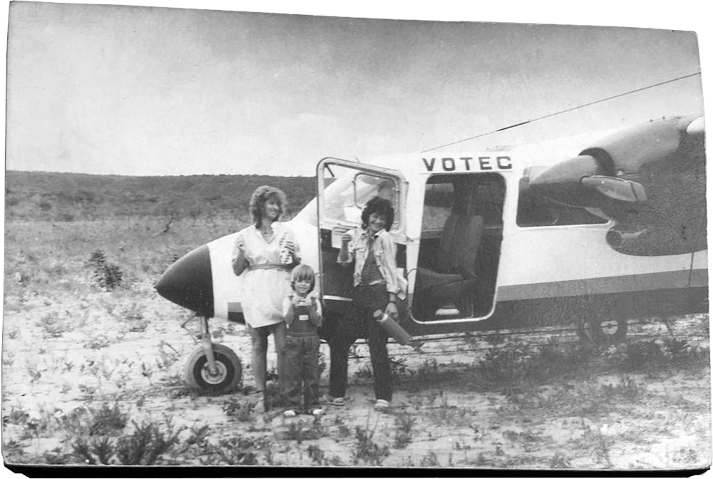Black and white photograph of my mother, my cousin and I by a Britten-Norman BN-2 Islander aircraft on a potato field.