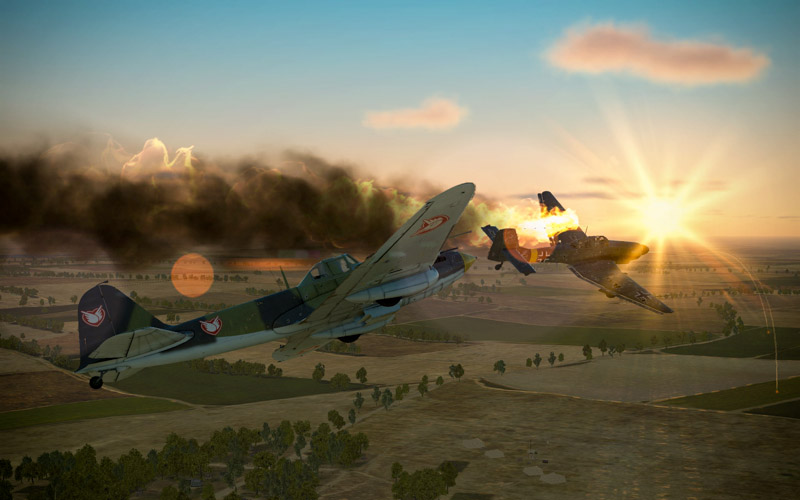 Stuka on fire being pursued by the player's IL-2 sporting the Combat Air Mail logo.