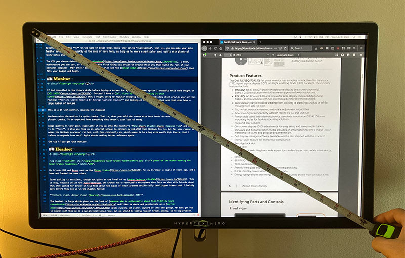 A photo of the Dell P2415Q monitor with a measuring tape placed diagonally across the screen.