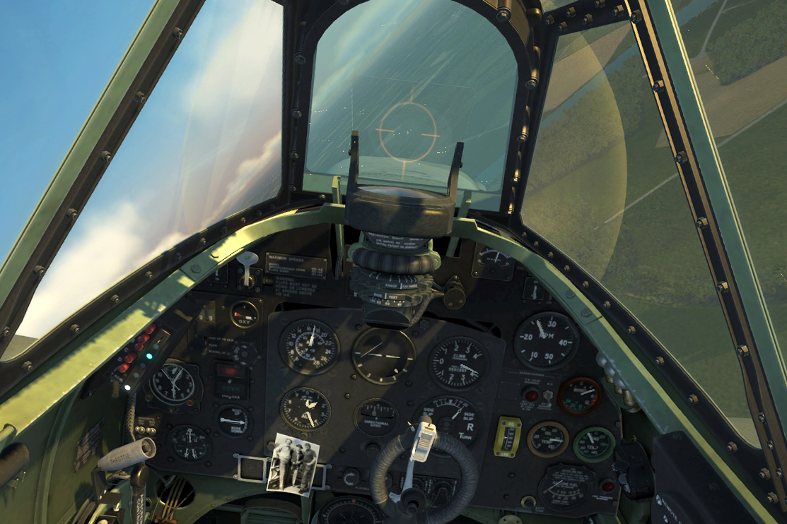 Spitfire cockpit with a photo of Alan, Frank and Peter.