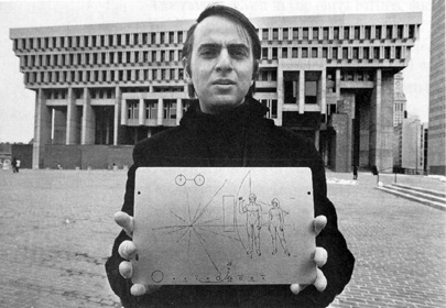 Carl Sagan holding the Pioneer plaque.